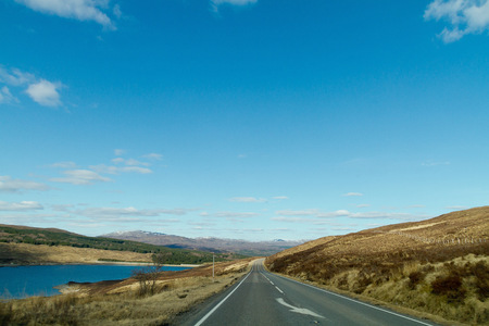 are taken: An amazing scenic view taken in the car looking at the road in the north of Scotland on a sunny day