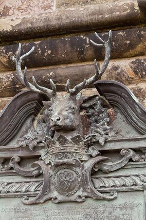 long weekend: Edinburgh Scotland  circa March 2013: A detail of an animal on the exterior of Edinburgh Castle on a cloudy day