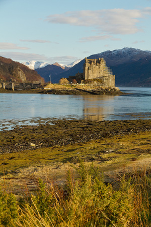 kyle: Kyle of Lochalsh Scotland  circa March 2013: A scenic view of Eilean Donan Castle on a sunny day with limitled clouds