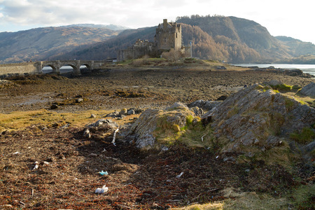 kyle: Kyle of Lochalsh Scotland  circa March 2013: A view of Eilean Donan Castle on a sunny day with limitled clouds