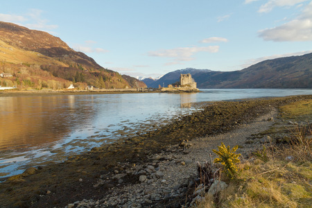 kyle: Kyle of Lochalsh Scotland  circa March 2013: A landscape view of Eilean Donan Castle  and the surrounded landscape on a sunny day with limitled clouds