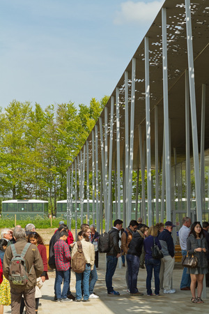 Amesbury England  circa May 2014:  A view of a long queue at the entrance of the Stonehenge Pavilion taken on a sunny day with limited clouds