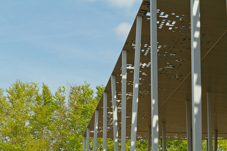 Amesbury England  circa May 2014: A detailed view of  the perforated metal roof of the Stonehenge Pavilion on a sunny day with limited clouds