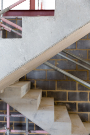 multi storey: A construction site with concrete stairs and scaffolding Stock Photo