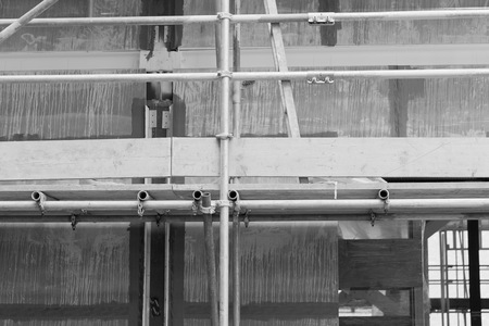built: A construction site with concrete slabs built held together with scaffolding