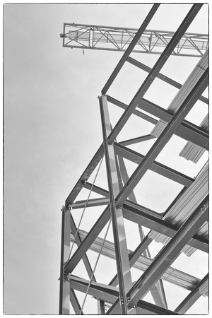 A Construction Site With Steel Framing And A Yellow Construction ...