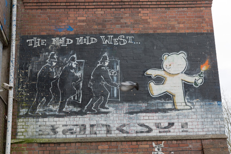 croft: April 2014 - Bristol, United Kingdom: A graffiti of Banksy called The Mild Mild West, of a bear with fire in his hand aiming at three police officers. The Mild Mild West, Hamilton House, Strokes Croft, BS1 3QY, Banksy Art