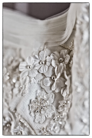A macro photo of a detailed white wedding dress with white flowers a macro photo of a detailed white wedding dress with white flowers and fake diamonds knitted mightylinksfo