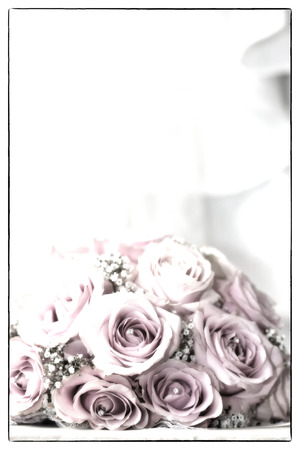 fake diamond: A coloured macro photo of a detailed bouquet with pink roses, white small flowers and a fake diamond in the centre of the roses, the wedding dress is in the back of the picture applied with a saturated vintage filter and a soft focus art filter