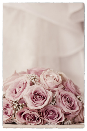 fake diamond: A coloured macro photo of a detailed bouquet with pink roses, white small flowers and a fake diamond in the centre of the roses applied with a saturated vintage filter and vintage black border Stock Photo