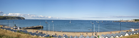 bournemouth: Swanage, Dorset, UK - July 2016. A panorama view of Swanage bay looking towards Bournemouth and Old Harry rock at Swanage in Dorset, UK Editorial