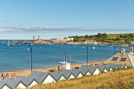 bournemouth: Swanage, Dorset, UK - July 2016. A view of Swanage bay looking towards Bournemouth and Old Harry rock at Swanage in Dorset, UK