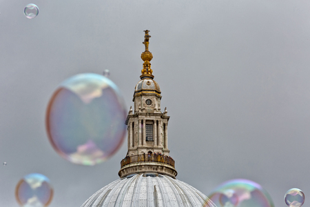 Bubbles from a street entertainer, with St Pauls Cathedral in the background, on the South Bank London