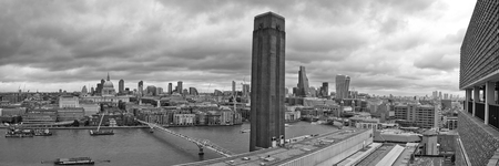 London, UK - July 2016: London panoramic view from Tate Modern Switch House roof observation terrace. London England. St Pauls Cathedral, Millennium Bridge