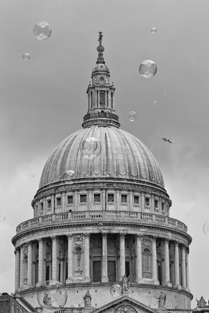 entertainer: London, UK - July 2016:  Bubbles from a street entertainer, with St Pauls Cathedral in the background, on the South Bank London Editorial