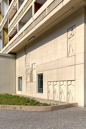unite: BERLIN, GERMANY - JULY 2014: The Modular Man on a side wall of Corbusier Haus was designed by Le Corbusier in 1957 following his concept of Unite dHabitation (Housing Unit)