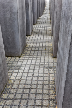 concentration camp: BERLIN, GERMANY - JULY 2015:  View of famous Jewish Holocaust Memorial near Brandenburg Gate in summer on July 27, 2015 in Berlin Mitte, Germany