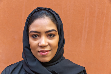 life partners: MILAN, ITALY - September 2015: Beautiful woman working for United Arab Emirates pavilion pavilion at World Expo, universal exposition on the theme of Feeding the Planet Energy for Life. Pavilion designed by Fosters and Partners Editorial