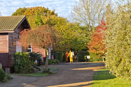 Hemel Hempstead, England - November 2016: Monks walking around the Amaravati Buddhist Monastery. The monastery is inspired by the Thai Forest Tradition and the teachings of the late Ajahn Chah, a Thai monk, a Thai monk and renowned Dhamma teacher.