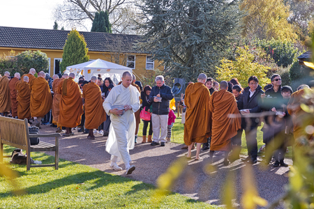 dhamma: Hemel Hempstead, England - November 2016: A Kathina Festival was held at Amaravati Buddhist Monastery on Sunday, 6 November 2016. The Kathina is a tradition that has been followed for over 2500 years. Lay followers make a special offering of the Kathina c Editorial