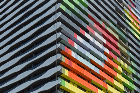 architectural firm: Melbourne, Australia - February 2015: Barak Building designed by ARM Architecture. The new apartment building has on one side a black and white portrait of William Barak and on the other side  colourful shapes. Currently being constructed on the old Car Editorial