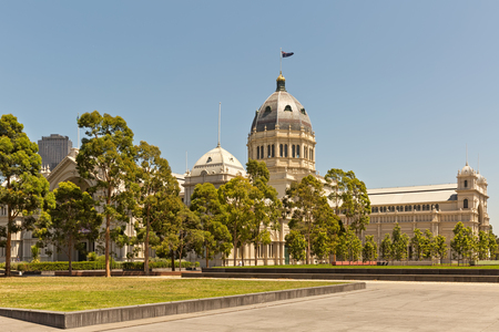 awarded: Melbourne, Australia - February 2015: Royal Exhibition Building behind Carlton Gardens in Melbourne, Victoria, Australia. First building in Australia to be awarded UNESCO world heritage status.