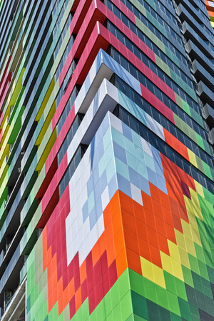 architectural firm: Melbourne, Australia - February 2015: Barak Building, a new apartment building with colourful facade being constructed on the old Carlton & United Brewery site on the corner of Swanston and Victoria Streets, Carlton