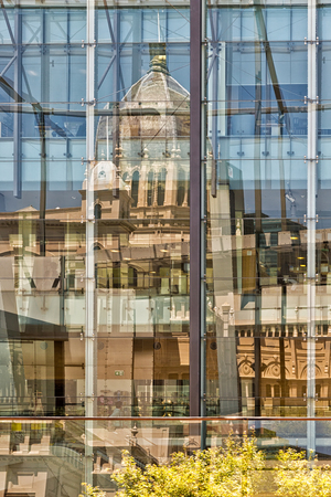 awarded: Melbourne, Australia - February 2015: Reflections of Royal Exhibition Building behind Carlton Gardens in Melbourne, Victoria, Australia. First building in Australia to be awarded UNESCO world heritage status.