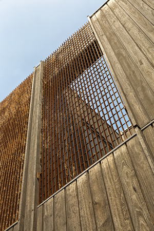 Urban Geometry, looking up to wooden building. Modern and abstract architecture design