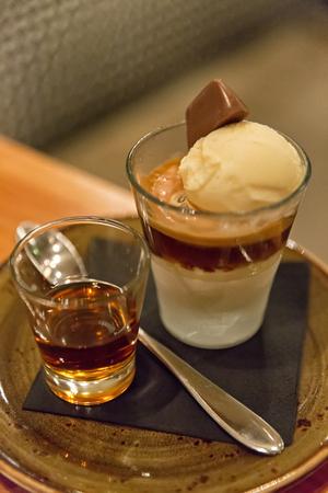 amaretto: Affogato - Vanilla Ice Cream, Espresso and Caramel Sauce, served with Amaretto