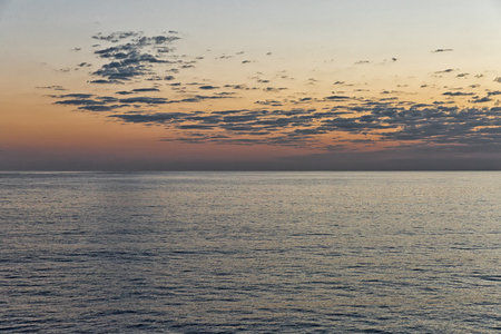 beautiful seascape with deep ocean waters and sunrise cloudscape