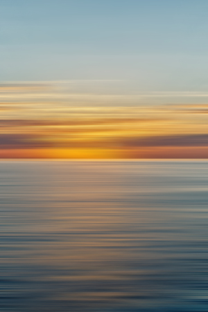 Colorful sunrise with long exposure effect, horizontal motion blurred for background Stock Photo