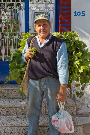 Amorgos Island, Greece - October 2015: Greek man posing.The people in Greece are affraid how the Greek debt crisis has his impact on there lives and work