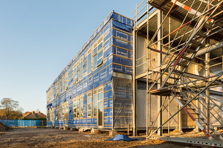 Poole, England - December 2014: Construction Site wrapped by blue waterproof membrane sheets