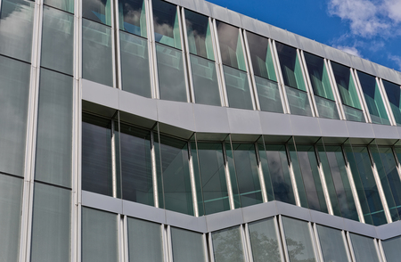 Berlin, Germany - July 2015: Unusual architectural detail on a modern building, curtain wall and stainless steel cladded facade. Buidling designed by OMA - Rem Koolhaas