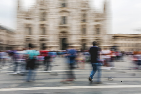 panning shot: Panning photograph of people walking on a shopping street with camera made motion blur Stock Photo