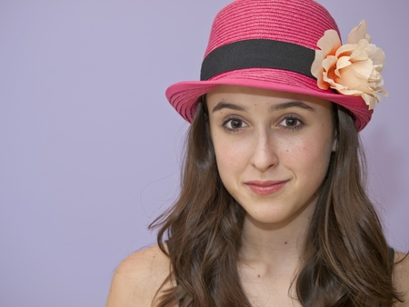 pink hat: Girl with pink hat.