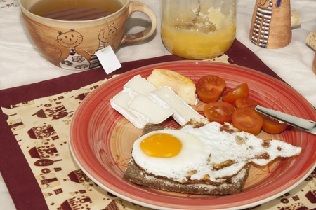 rigor: homemade breakfast bread with butter egg and cherry tomatoes Stock Photo
