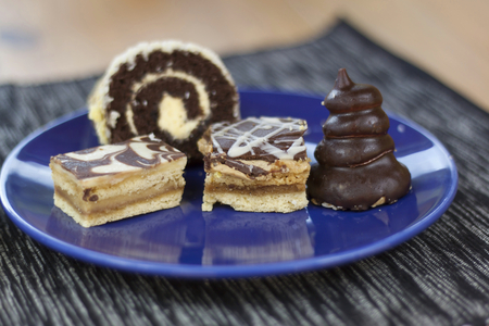 self made: dessert with coffee chocolate cakes and rolls on the table blurred background Stock Photo