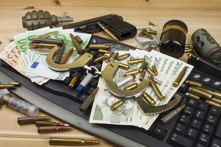 arms trade: Internet illegal arms trade. Merchant arrest illegal ammunition. Internet crime. Current euro banknotes and Czech koruna. Stock Photo