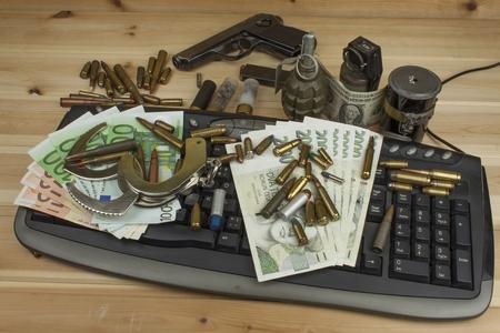 internet crime: Internet illegal arms trade. Merchant arrest illegal ammunition. Internet crime. Current euro banknotes and Czech koruna. Stock Photo