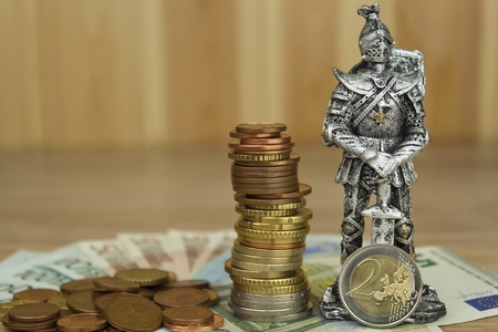 Defending European Union protection of the common currency. Danger for EURO currency. Knight prevent euro coins. Fight to maintain the common currency of the European Union. Stock Photo