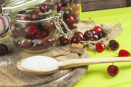 domestic production: Domestic production of cherry jam. Freshly picked cherries ready for canning. The supply of fruits for the winter and a rainy day. The preparation of sweets for the family. Stock Photo