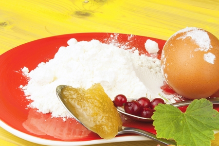 domestic production: Ingredients for domestic production currant dessert. Flour, eggs, honey and red currants. Chef prepares the ingredients to bake a dessert. Stock Photo