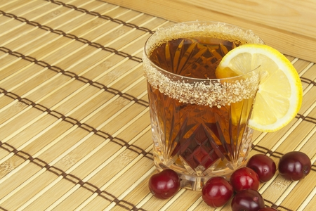 refreshment: Glasses with cherries with rum. Preparing for summer refreshment cocktail. Cane rum and sugar. Sour pickled in rum. Stock Photo