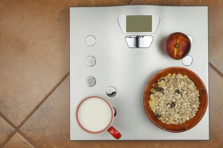 weight control: Personal scale in the bathroom. The concept of diet and weight control. Healthy nutrition and obesity.