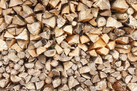 outdoor fireplace: Ready firewood. Various kinds of wooden logs stacked on top of each other. Stack of wood, firewood, background. Dry chopped firewood logs ready for winter.