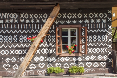 a window on the world: Old wooden window. Unique decoration of log houses based on patterns used in traditional embroidery in village of Cicmany, UNESCO World Heritage Site, Slovakia