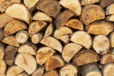 metall texture: Background of stacked wood. Ready firewood. Various kinds of wooden logs stacked on top of each other. Stack of wood, firewood, background. Dry chopped firewood logs ready for winter.