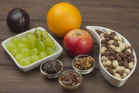 food concept: Healthy Diet breakfast of oatmeal, cereal and fruit. Foods full of energy for athletes. The concept of diet food. Preparing homemade breakfast. Vegetarian diet. Food on a wooden table.